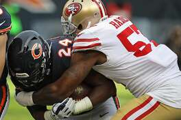 CHICAGO, IL - DECEMBER 03:   Jordan Howard #24 of the Chicago Bears is dropped by Eli Harold #57 of the San Francisco 49ers at Soldier Field on December 3, 2017 in Chicago, Illinois. The 49ers defetaed the Bears 15-14. (Photo by Jonathan Daniel/Getty Images)