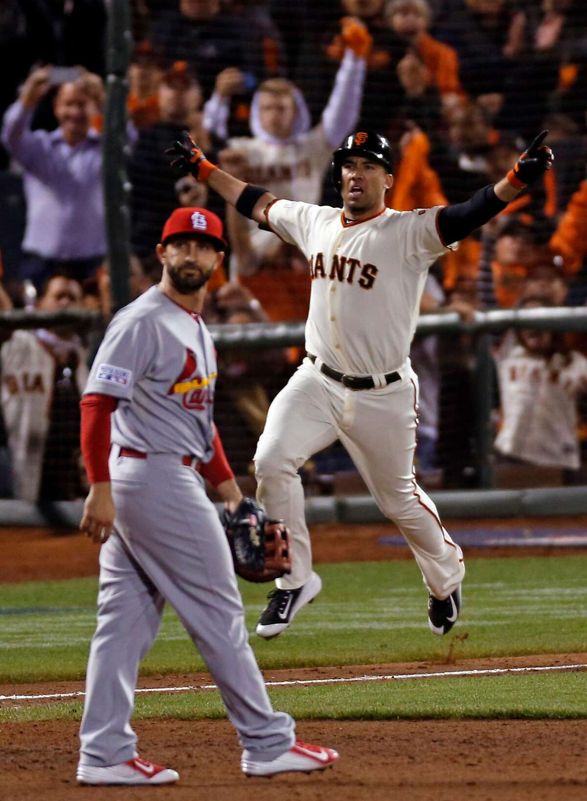 San Francisco Giants' Travis Ishikawa hits a game-winning 3-run home run in 9th inning of 6-3 win over St. Louis Cardinals in Game 5 of the NLCS at AT&T Park in San Francisco, Calif. on Thursday, October 16, 2014.