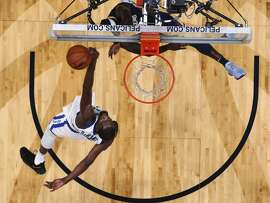 Golden State Warriors forward Kevin Durant, below, blocks a shot by New Orleans Pelicans guard Jrue Holiday in the first half of an NBA basketball game in New Orleans, Friday, Oct. 20, 2017. (AP Photo/Gerald Herbert)