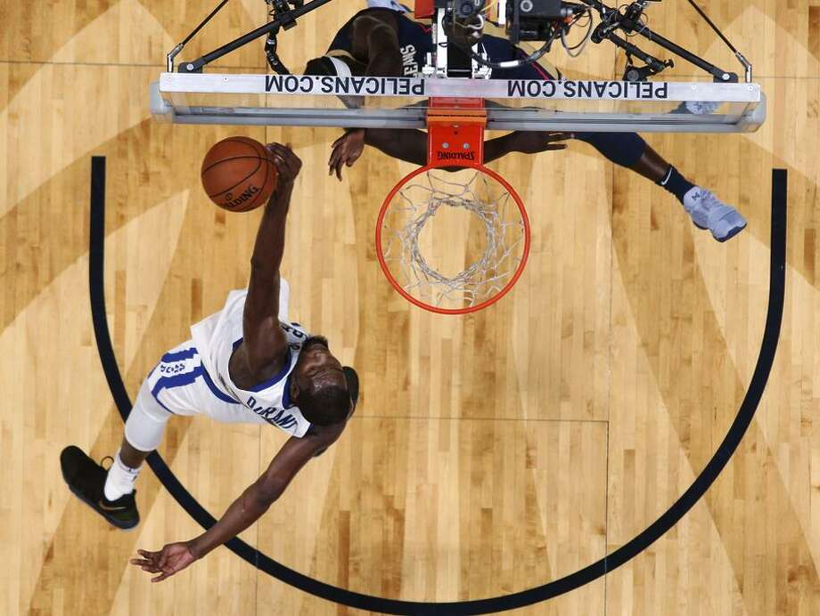 Warriors forward Kevin Durant, shown blocking Jrue Holiday of the Pelicans, is averaging a career-high 2.1 blocks. Photo: Gerald Herbert / AP / Copyright 2017 The Associated Press. All rights reserved.
