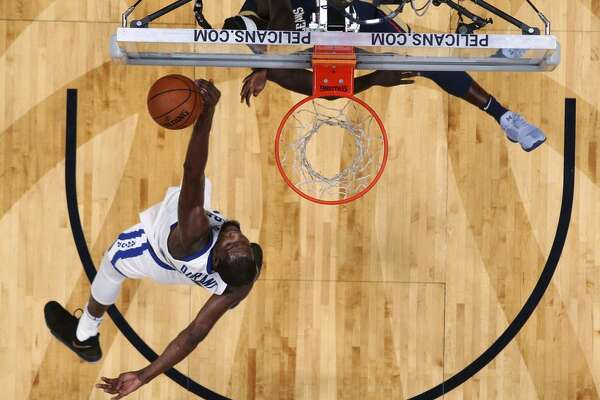 Warriors forward Kevin Durant, shown blocking Jrue Holiday of the Pelicans, is averaging a career-high 2.1 blocks.