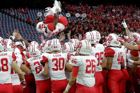 Katy's Dylan Ashwood is tossed above his teammates before they team took on Cypress Ranch for the playoffs  at NRG Stadium on Saturday, Nov. 25, 2017, in Houston. Katy won the game 55-7. ( Elizabeth Conley / Houston Chronicle )