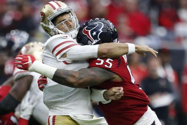 Houston Texans inside linebacker Benardrick McKinney (55) hits San Francisco 49ers quarterback Jimmy Garoppolo (10) after Garoppolo threw a pass during the third quarter of an NFL football game at NRG Stadium, Sunday, Dec. 10, 2017, in Houston.  ( Karen Warren / Houston Chronicle )