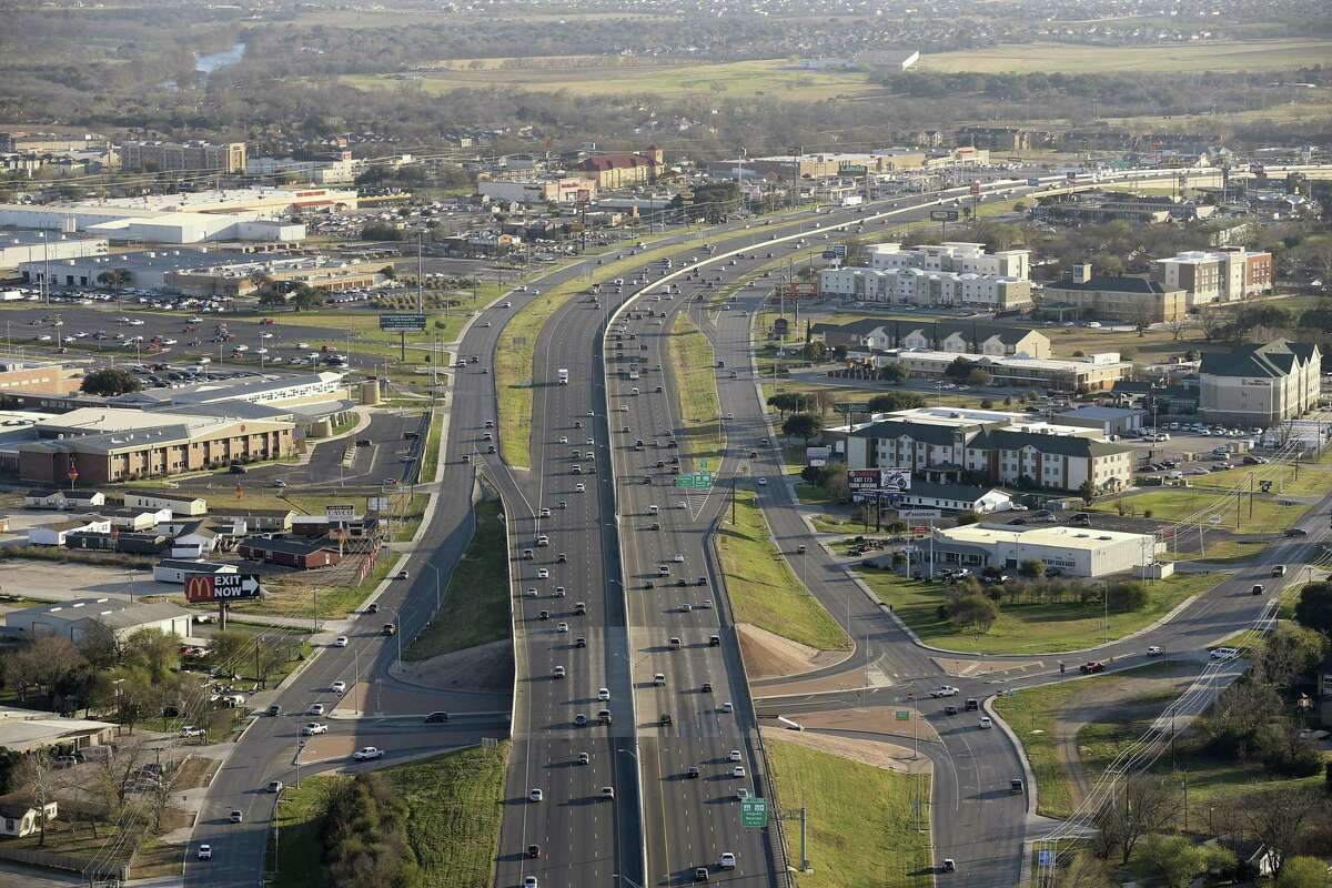 Traffic moves along IH-35 in New Braunfels, Texas, Thursday, Feb. 18, 2016. North Business Interstate 35 veers to the right and Canyon High School is on the middle left of this frame.
