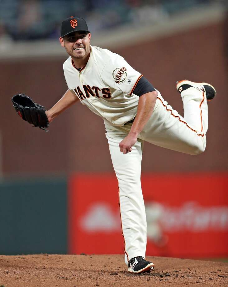 San Francisco Giants' Matt Moore grimaces after throwing a pitch against Los Angeles Dodgers in 1st inning during MLB game at AT&T Park in San Francisco, Calif., on Wednesday, September 13, 2017. Photo: Scott Strazzante, The Chronicle