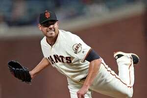 San Francisco Giants' Matt Moore grimaces after throwing a pitch against Los Angeles Dodgers in 1st inning during MLB game at AT&T Park in San Francisco, Calif., on Wednesday, September 13, 2017.