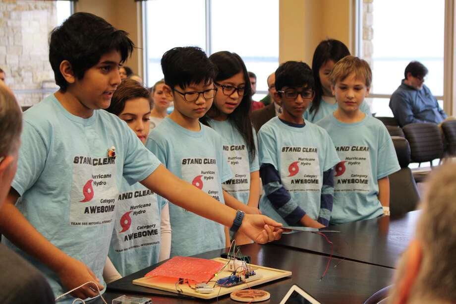 Hurricane Hydro, a First Lego League Robotics team from Mitchell Intermediate School in The Woodlands, present their Hydrologicai project to San Jacinto River Authority Manager Board of Directors at the SJRA board meeting on Thursday, Dec. 13. Photo: Michelle Iracheta