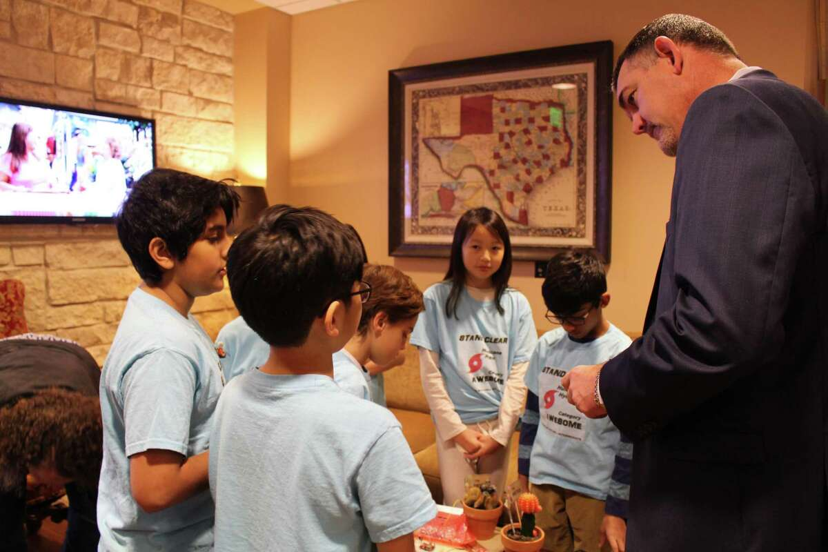 Hurricane Hydro, a First Lego League Robotics team from Mitchell Intermediate School in The Woodlands, present their Hydrologicai project to San Jacinto River Authority Manager Jace Houston at SJRA board meeting on Thursday, Dec. 13.