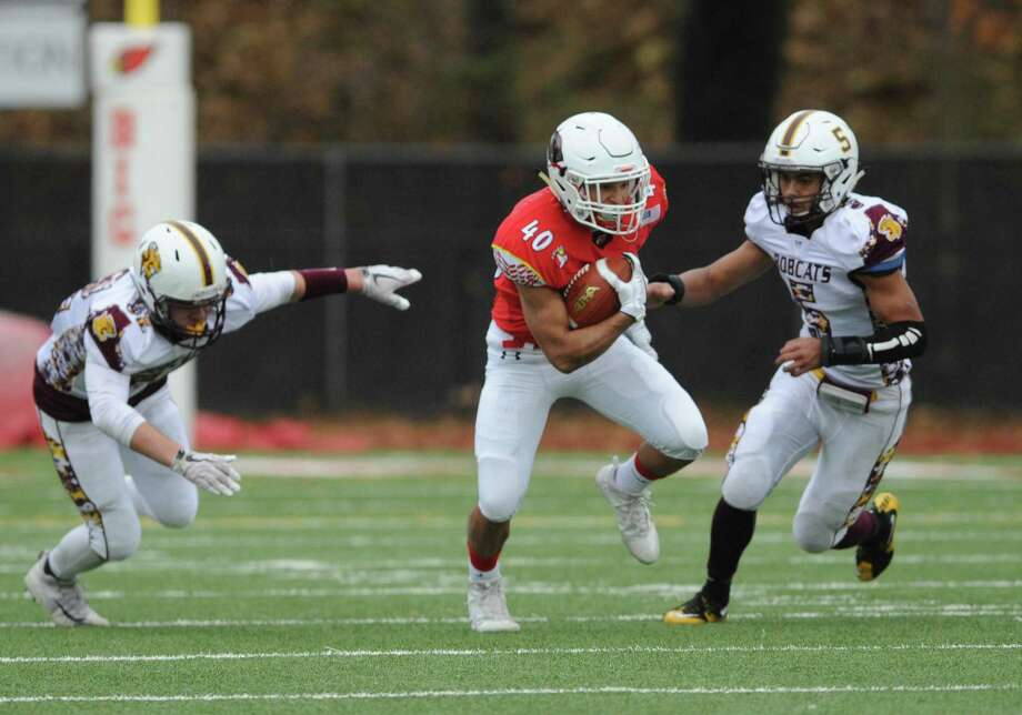 Greenwich High junior running back Tysen Comizio looks for open room in the Cardinals' 36-7 win over South Windsor in Class LL state semifinals. Comizio finished the season with 1,379 rushing yards and 20 touchdowns. Photo: Tyler Sizemore / Hearst Connecticut Media / Greenwich Time