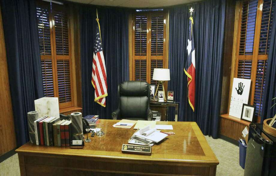 The mayor's office spent nearly $18,000 in faux silk curtains that can be opened and closed with a remote control. Photo: Tom Reel /San Antonio Express-News / 2017 SAN ANTONIO EXPRESS-NEWS