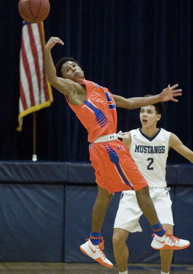 Danbury High School's Javon Hernandez leaps for a loose ball during a game against Immaculate High School, played at Immaculate. Monday, Dec. 19, 2016 Photo: Scott Mullin / For Hearst Connecticut Media / The News-Times Freelance