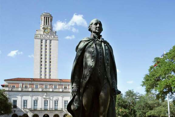 A statue of George Washington stands on the plaza underneath the tower  at the University of Texas at Austin. (Tom Reel/San Antonio Express-News)