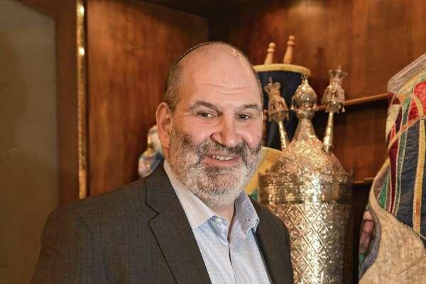 Rabbi Matthew Cuttler stands in the sanctuary at Congregation Gates of Heaven on Wednesday, Dec. 13, 2017 in Schenectady, N.Y. (Lori Van Buren / Times Union)