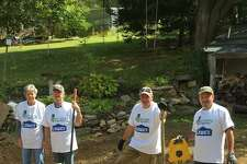 Rebuilding Together partnered with Lowe's to replace the septic system at a veteran's house in New Preston.