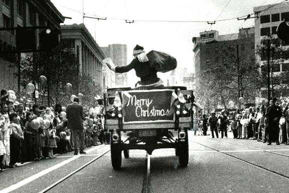 The Emporium's Santa Claus rides down Market Street during a holiday parade.