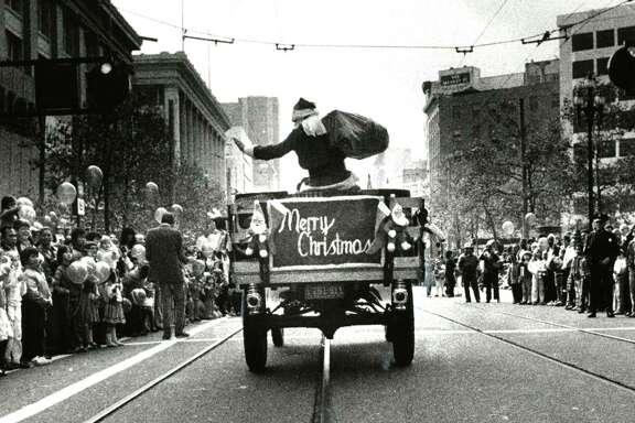 The Emporium's Santa Claus rides down Market Street during a holiday parade.