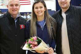 Immaculate High School senior girls soccer goalkeeper Kristen Roessler, center, along with coaches Nelson Mingachos, left, and Brad Jeeves, right.