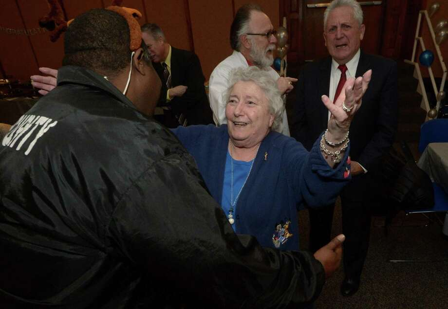 Friends, family and coworkers including Charles Hankerson show their appreciation for Marie Patchen as Norwalk Public Schools hosts a surprise retirement celebration for Patchen, the long time payroll coordinator for the city Friday, December 15, 2017, in the Community Room at City Hall in Norwalk, Conn. Patchen, 80, has worked for the NPS for her entire career and is something of a City Hall institution. Patchen also graduated high school from the building when City Hall was the original Norwalk High School. Photo: Erik Trautmann / Hearst Connecticut Media / Norwalk Hour