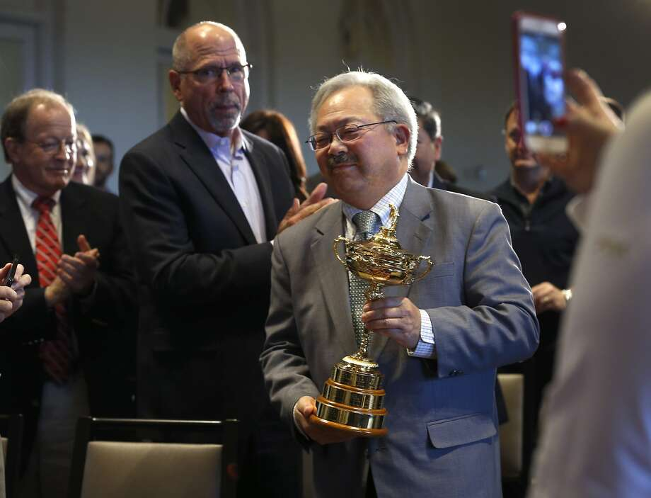 Mayor Ed Lee carried the Ryder Cup to the stage on Nov. 8 after PGA of America officials announced that the Olympic Club will host the 2028 PGA Championship and the Ryder Cup in 2032. Photo: Paul Chinn, The Chronicle