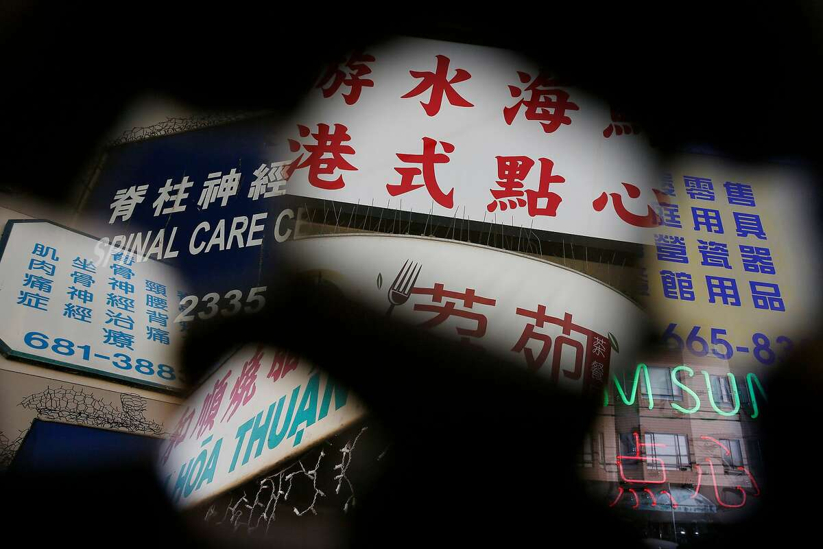 Signs on storefronts along Irving Street are seen in a multiple exposure on Thursday, December 14, 2017 in San Francisco, Calif.