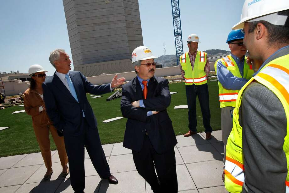 Mayor Ed Lee (center) tours the rooftop garden of the Furniture Mart in May 2012, under renovations to become Twitter's offices. Photo: Sarah Rice, Special To The Chronicle