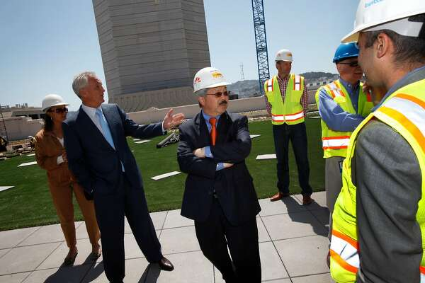 San Francisco Mayor Ed Lee, center, tours the rooftop garden of the SF Furniture Mart, which is under renovations to become Twitter's offices in San Francisco, Calif., Thursday, May 10, 2012.  One of Mayor Lee's first policy decisions was pushing a tax break for the downtrodden Mid-Market area to keep Twitter Inc. from leaving the city.
