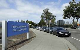 FILE - In this Sept. 14, 2017 file photo, an area adjacent to the Peralta Community College District headquarters is seen in Oakland, Calif. The Oakland Athletics are left to consider yet another site to build a new ballpark after the team's top choice of location near Laney College fell through with the board of Peralta Community College District. A's President Dave Kaval and his team had considered this the top spot and had engaged in conversations with community members, officials and business owners in the area in hopes of building a privately financed ballpark to open as soon as 2023. (AP Photo/Ben Margot, File)
