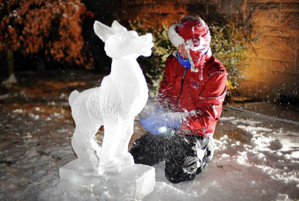 Ice carver Gary Costa with Ice Matters in Cheshire, works on a Rudolph the Red-nosed Reindeer ice sculpture during Pequot Library's New England Holiday Caroling Party and Open House in Southport, Conn., on Friday, December 15, 2017. The party featured horse-drawn carriage rides through Southport Village, the choirs from both St. Thomas Aquinas Parish and Our Saviour's Lutheran Church, crafts and cookie decorating for youngsters, seasonal beverages for adults and children, ice sculptures by Ice Matters and a warming fire.