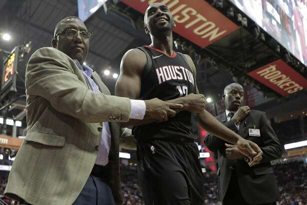 Houston Rockets forward Luc Mbah a Moute (12) is taken out of the game against the Charlotte Hornets at the Toyota Center on Wednesday, Dec. 13, 2017, in Houston. ( Elizabeth Conley / Houston Chronicle )