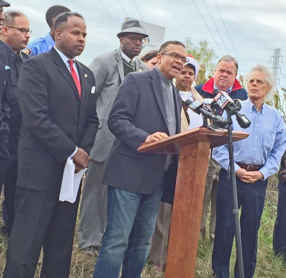 """Speaking at a Dec. 15, 2017 press conference, Fort Bend County Precinct 2 Justice of the Peace Joel Clouser Sr. said he lives in a neighborhood near the chemical spill and questioned why remediation efforts were taking so long. """"It's been over a week and I'm very concerned. When is the smell going to stop?"""" he said. """"I'm concerned there could be long-term effects from exposure to these toxic chemicals in the air."""" State Rep. Ron Reynolds stands to the left of Clouser. Photo: Kristi Nix"""