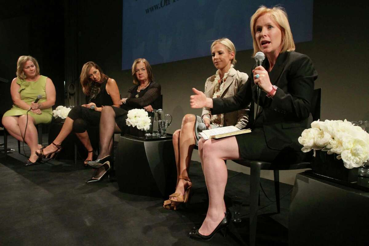 FILE - In this June 2, 2011 file photo, Sen. Kirsten Gillibrand, D-N.Y., right, speaks, as Kiki McLean, left, Donna Karan, second from left, Judy McGrath, center, and Tory Burch listen during a