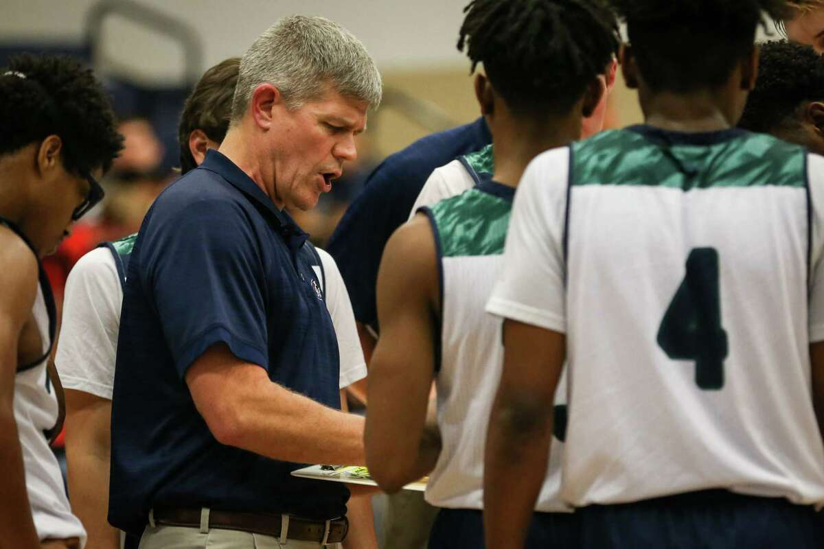 College Park head coach Clifton McNeely guides his team during the high school boys basketball game against Goose Creek Memorial on Friday, Dec. 15, 2017, at College Park High School. (Michael Minasi / Houston Chronicle)