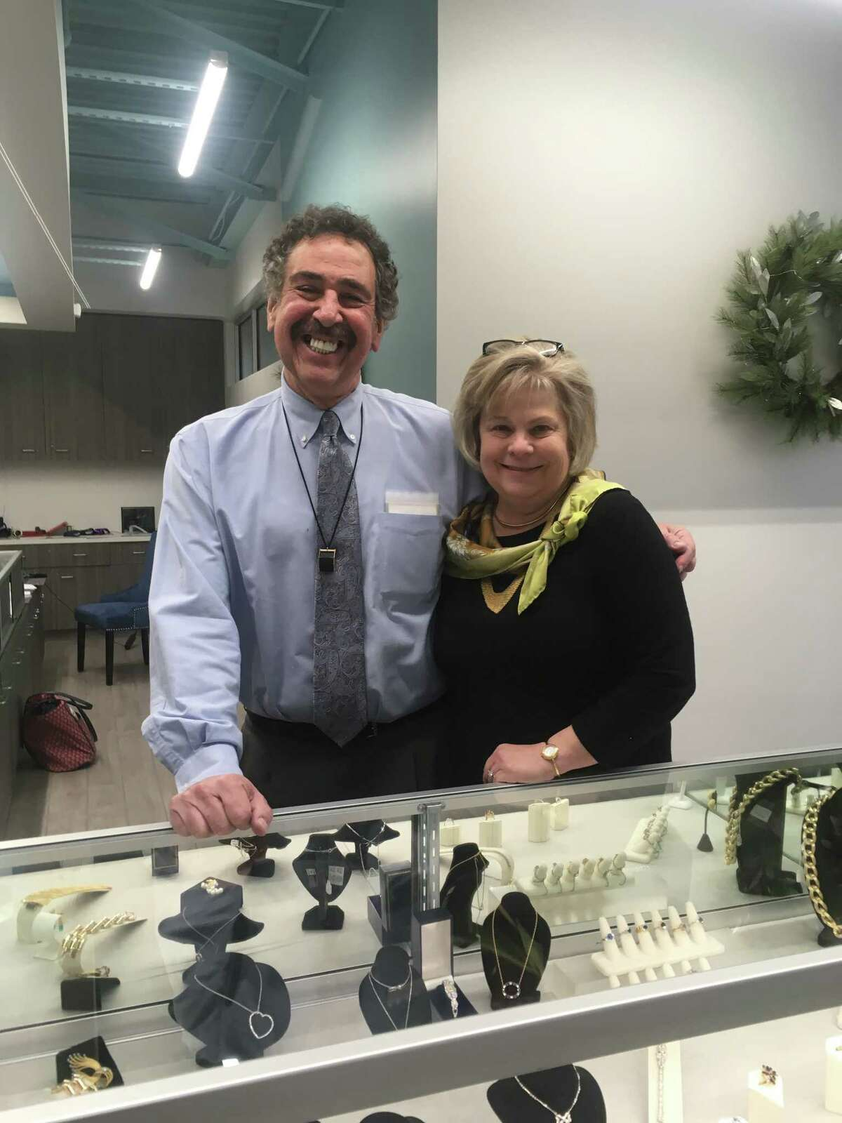 Jeffrey Anolik, owner ofJeffrey and Company Jewelers,a jewelry store that specializes in Victorian-era and estate jewelry,stands beside a display case. The store opened its doors the first of December in Crossroads Square at Creekside Park in The Woodlands.