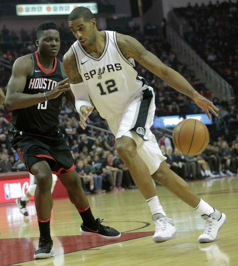Houston Rockets center Clint Capela (15) guards San Antonio Spurs forward LaMarcus Aldridge (12) as he drives the the basket in the first quarter at the Toyota Center on Friday, Dec. 15, 2017, in Houston. Photo: Elizabeth Conley, Houston Chronicle / © 2017 Houston Chronicle