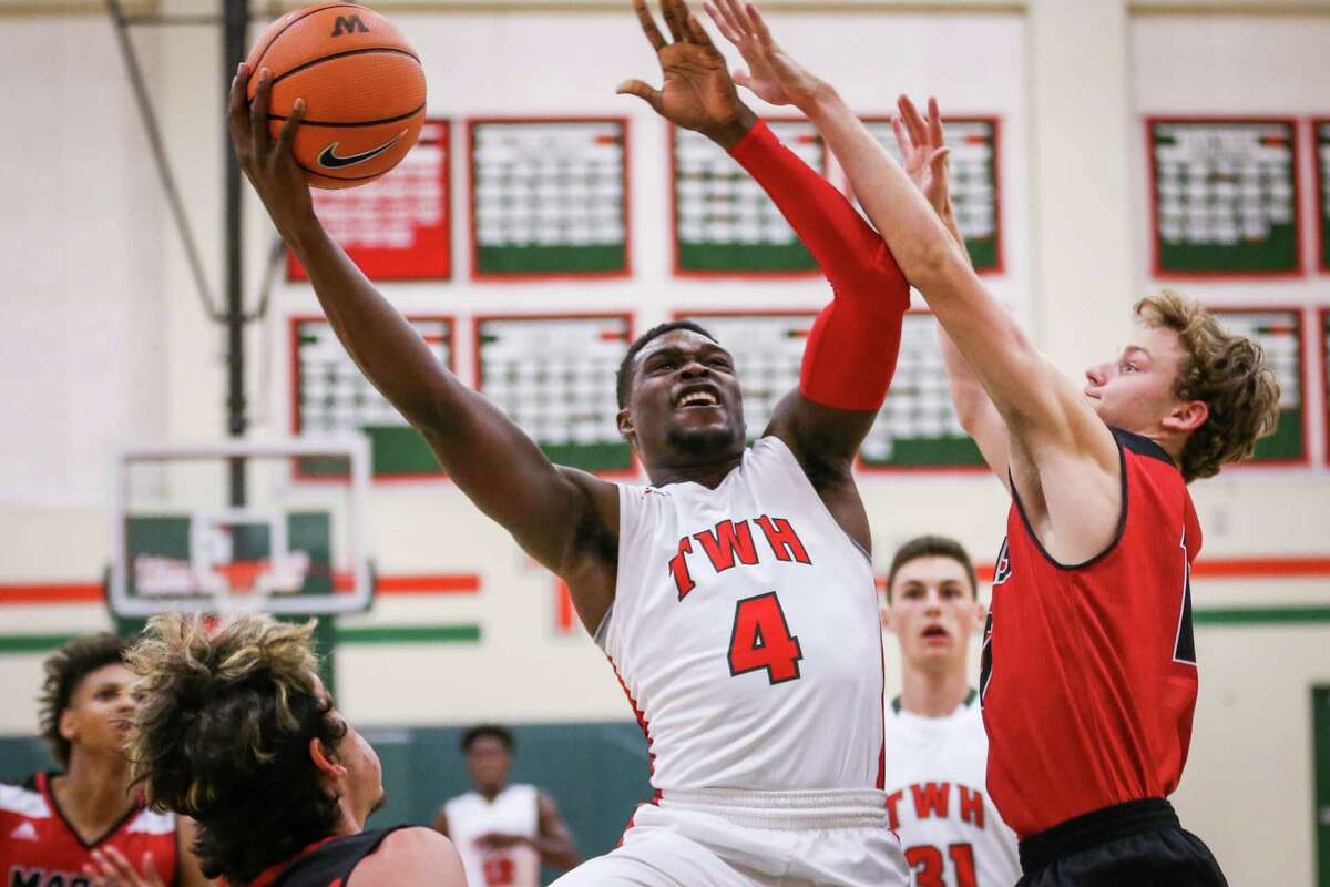 The Woodlands' Romello Wilbert (4) shoots during the high school boys basketball game against Flower Mound Marcus on Saturday, Nov. 25, 2017, at The Woodlands High School. (Michael Minasi / Houston Chronicle)