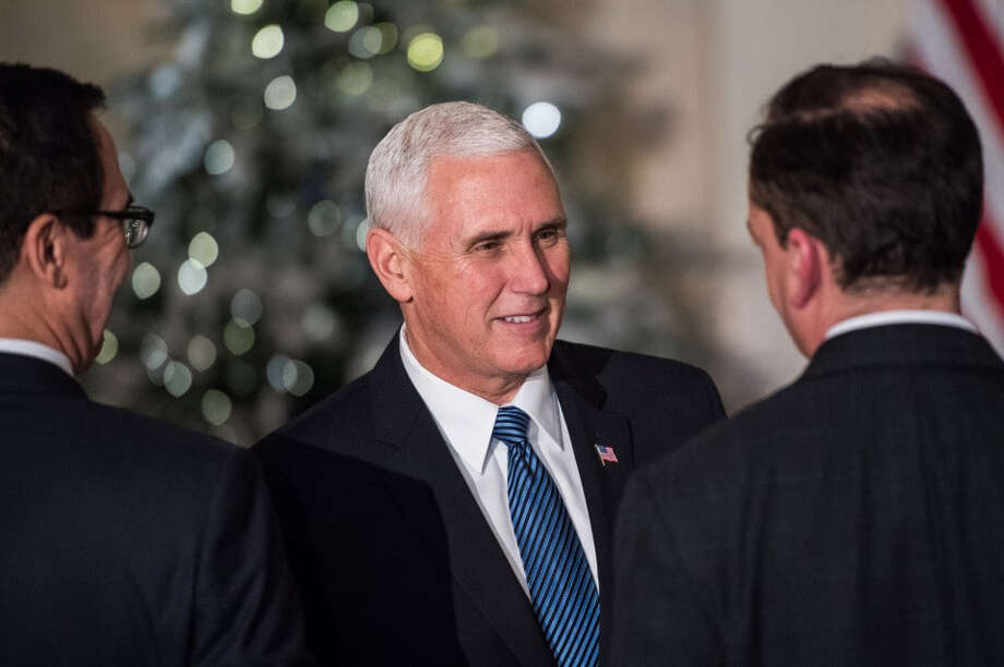 Vice President Mike Pence shake hands before President Donald Trump makes remarks on tax reform at the Grand Foyer of the White House on Wednesday. MUST CREDIT: Washington Post photo by Salwan Georges Photo: Salwan Georges / The Washington Post