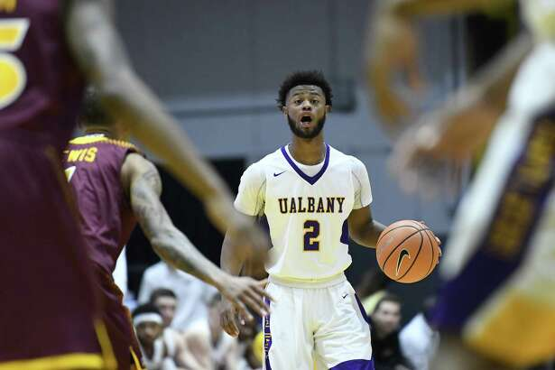Albany Great Danes guard Ahmad Clark (2) moves the ball against the Iona Gaels defenders during the first half of an NCAA men's college basketball game on Friday, Nov. 10, 2017, in Albany, N.Y. (Hans Pennink / Special to the Times Union) ORG XMIT: HP114 ORG XMIT: MER2017111021562053