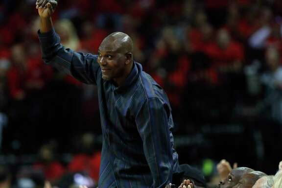 Hakeem Olajuown waves to the crowd at a playoff game at Toyota Center. Olajuwon was intrumental in bringing consecutive NBA titles to Houston.