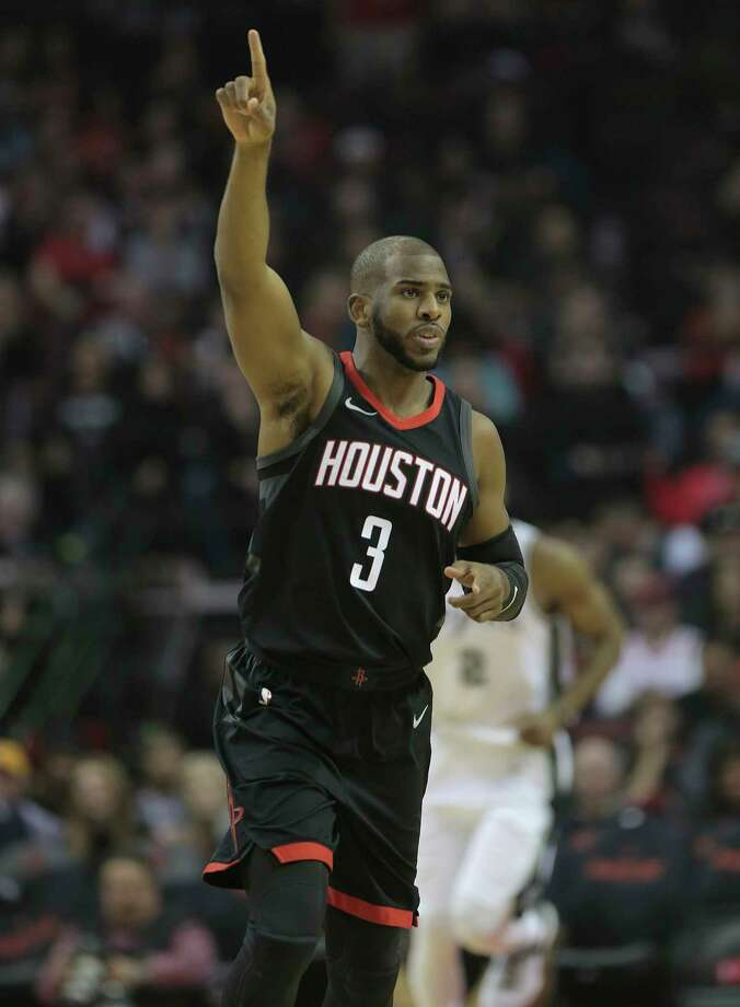 Rockets guard Chris Paul signals a converted bucket against the Spurs on Friday night at Toyota Center.  Paul also had eight assists and was 10-for-18 from the field. Photo: Elizabeth Conley, Chronicle / © 2017 Houston Chronicle