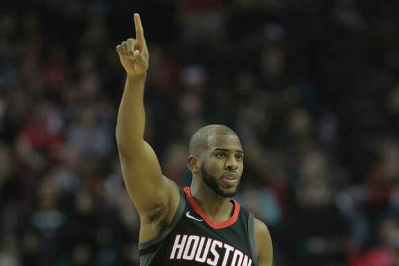 Rockets guard Chris Paul signals a converted bucket against the Spurs on Friday night at Toyota Center.  Paul also had eight assists and was 10-for-18 from the field.