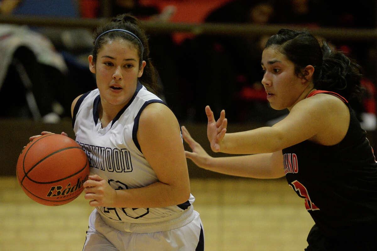 Greenwood's Ariana Leyva (23) dribbles against Levelland's Natalie Velardez (21) on Dec. 15, 2017, at Greenwood High School. James Durbin/Reporter-Telegram