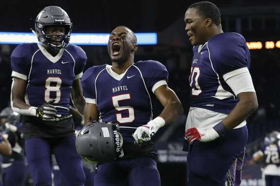 Manvel Mavericks wide receiver Kam Scott (8), wide receiver Jalen Preston (5), and Stephen Shaw (70) celebrate after the high school football semifinal playoff playoff game between the Manvel Mavericks and the Angleton Wildcats at NRG Stadium in Houston, TX on Friday, December 15, 2017.