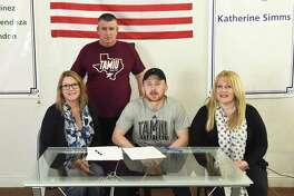 Jake Eynon is joined by his stepmother Emma Eynon, his father Tony Eynon and his mother Jane Coe Friday as he signed on with the Team Solent Kestrels.