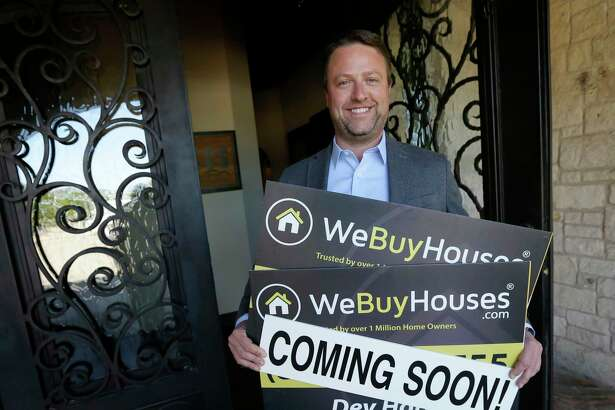 In this Monday, Oct. 30, 2017, photo, Jeremy Brandt, CEO of We Buy Houses, poses for a photo outside his office in Bedford, Texas. Brandt's company survived the Great Recession by shifting focus. (AP Photo/Tony Gutierrez)