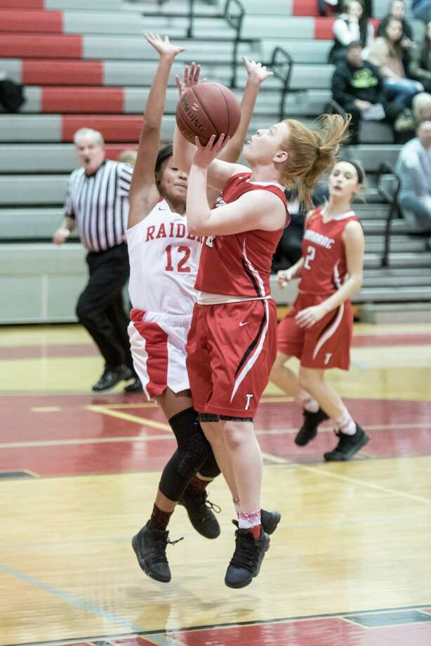 Tamarac's Kayla Doody goes for a basket past Mechanicville's Jada Brown Friday, December 15th, 2017, during the game at Mechanicville. Photo By Eric Jenks Photo: Eric Jenks / Eric Jenks 2017