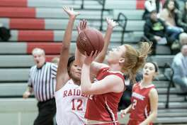 Tamarac's Kayla Doody goes for a basket past Mechanicville's Jada Brown Friday, December 15th, 2017, during the game at Mechanicville. Photo By Eric Jenks