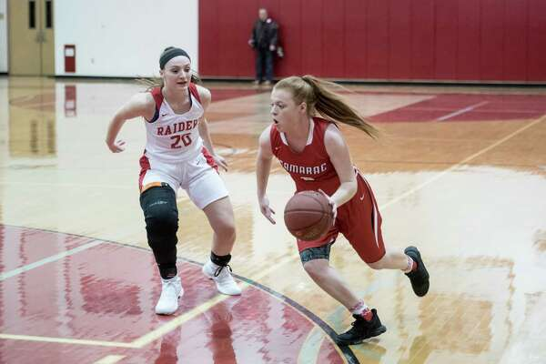 Tamarac's Kayla Doody goes for a basket past Mechanicville's Taylor Grayson Friday, December 15th, 2017, during the game at Mechanicville. Photo By Eric Jenks