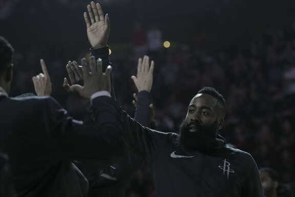 Houston Rockets guard James Harden (13) shakes hands with his teammates before they take on the San Antonio Spurs at the Toyota Center on Friday, Dec. 15, 2017, in Houston. ( Elizabeth Conley / Houston Chronicle )