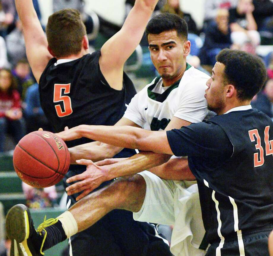 Sandwiched between Bethlehem's #5 Eric Salo, left, and #34 Kenny Clanton, Shen's #3 Abbas Merchant draws a foul during their game Friday Dec. 15, 2017 in Clifton Park, NY. (John Carl D'Annibale / Times Union) Photo: John Carl D'Annibale / 20042420A