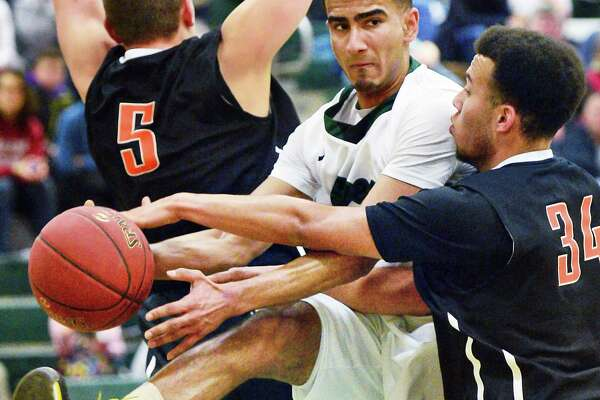 Sandwiched between Bethlehem's #5 Eric Salo, left, and #34 Kenny Clanton, Shen's #3 Abbas Merchant draws a foul during their game Friday Dec. 15, 2017 in Clifton Park, NY. (John Carl D'Annibale / Times Union)